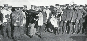 Serving out winter coats to British soldiers. Courtesy of The Manchester Guardian History of the War Vol II 1914-1915.