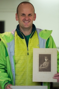 Tom Sleigh holds picture of Great Uncle Billy/ CfCC Searchroom