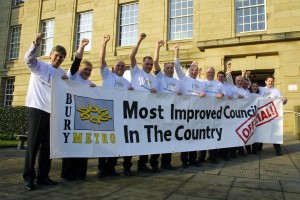 Holding the banner after the Council were awarded 'The Most Improved Council' title as acknowledged by the Audit Commission