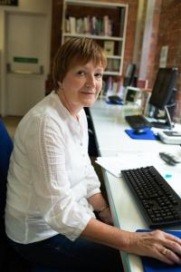 Christine Barrett, volunteer, extracting newspaper content.