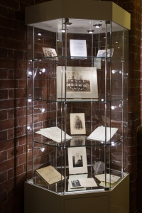 Display case containing photographs and documents of William Ward Sleigh.